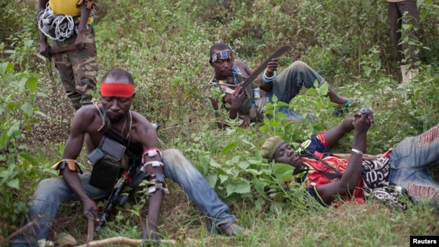 Anti-balaka fighters from the town of Bossembele rest while on patrol in the Boeing district of Bangui, Central African Republic, February 24, 2014.