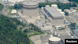 FILE - An aerial view shows Japan Atomic Power Co.'s Tsuruga nuclear power plant in Tsuruga, Fukui prefecture, in this photo taken by Kyodo.