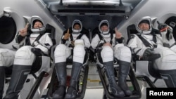 NASA astronauts Shannon Walker, left, Victor Glover, Mike Hopkins, and Japan Aerospace Exploration Agency (JAXA) astronaut Soichi Noguchi react inside the SpaceX Crew Dragon Resilience spacecraft onboard the SpaceX GO Navigator recovery ship May 2, 2021. (NASA/Bill Ingalls)