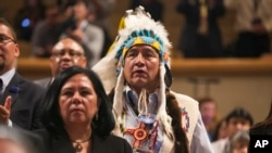 FILE - Lee Juan Tyler of Idaho waits for President Barack Obama to speak at the 2015 White House Tribal Nations Conference, Nov. 5, 2015. Despite the problems facing Native Americans, they rarely are a priority in U.S. presidential elections.