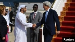 U.S. Secretary of State John Kerry is greeted by Shehab Al-Fahim from the Ministry of Foreign Affairs upon his arrival in Abu Dhabi, United Arab Emirates, Nov. 15, 2016.