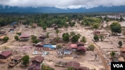 A scene of recent flooding in Laos. A new UN global warming report says the world is already seeing the effects of warming with increasing and more powerful natural disasters.