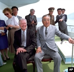 Kim Il Sung sits alongside former U.S. President Jimmy Carter in June 1994, just weeks before Kim's death. Their talks in Pyongyang helped broker a U.S.-DPRK nuclear deal, but the accord fell apart in 2002.