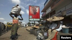 A poster shows John Dramani Mahama, Ghana's interim president and National Democratic Congress (NDC) presidential candidate, on a street in Accra, December 2, 2012.