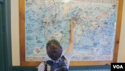 An Austrian tourist marks her route on a map in Williams, Arizona