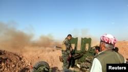 Ảnh tư liệu - Lực lượng peshmerga trong một cuộc đụng độ với các chiến binh Nhà nước Hồi giáo ở một ngôi làng phía đông Mosul, Iraq, ngày 29 tháng 5 năm 2016.