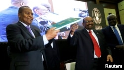 Central African Republic President Faustin-Archange Touadera is seen with Sudan's President Omar al-Bashir after signing a peace deal between the Central African Republic government and 14 armed groups following talks in the Sudanese capital Khartoum, Sudan, Feb. 5, 2019.