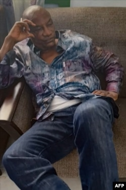 A screengrab taken from footage sent to AFP by a military source shows the President of Guinea Conakry Alpha Conde after he was captured by army putschists during a coup d'etat in Conakry on September 5, 2021.