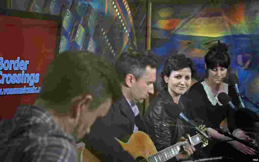 """The Cranberries' lead singer, Dolores O'Riordan, smiles for the camera during the interlude to the band's classic song """"Linger""""."""