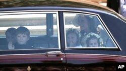 Kate, the Duchess of Cambridge arrives with Prince George (L) and Princess Charlotte (R) for the wedding ceremony of Prince Harry and Meghan Markle at St. George's Chapel in Windsor Castle in Windsor, near London, England, May 19, 2018.