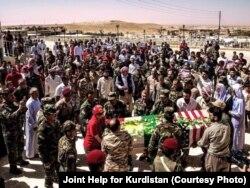FILE - Yazidi people gather during the burial ceremony of Leland Scott in Sharfadin shrine, Duhok, Iraq, June 21, 2016.