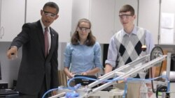 President Obama with students Meghan Clark and Nathan Hughes and a robot last month at Thomas Jefferson High School for Science and Technology in Alexandria, Virginia