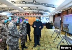 Chinese President Xi Jinping learns about the hospital's operations, treatment of patients, protection for medical workers and scientific research in Wuhan, the epicenter of the novel coronavirus outbreak, Hubei province, China, March 10, 2020.