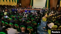 Participants attend a session of the 43rd ECOWAS meeting in Abuja July 17, 2013.