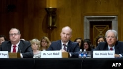 L-R: Dr. Frederick W. Kagan, Christopher DeMuth Chair and Director of the Critical Threats Project at the American Enterprise Institute, Scott Modell, testify before the US Senate Foreign Relations Committee, June 12, 2014 on Capitol Hill in Washington, DC.