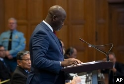 Gambia's Justice Minister Aboubacarr Tambadou addresses judges of the International Court of Justice for the first day of three days of hearings in The Hague, Netherlands, Tuesday, Dec. 10, 2019.