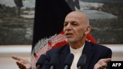 FILE - Afghan president Mohammad Ashraf Ghani speaks during a press conference at Presidential Palace in Kabul on June 30, 2018.