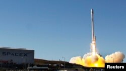 A Falcon 9 rocket carrying a small science satellite for Canada is seen as it is launched, Sept. 29, 2013.