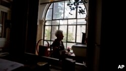 FILE - In this Jan. 20, 2016, photo, Dutch Israeli holocaust survivor Mirjam Bolle is seen in her house in Jerusalem. Throughout the Nazi occupation of Amsterdam, and while incarcerated in two prison camps, Bolle wrote letters to her fiance that she never