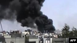 Amaterski snimak granatiranja pobunjeničkih četvrti u sirijskom gradu Homsu