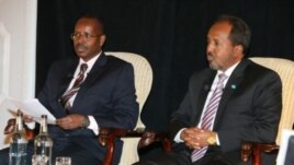 VOA's Harun Maruf and President of Somalia Hassan Sheikh Mohamud attend VOA's Youth London Town Hall meeting in May 2013