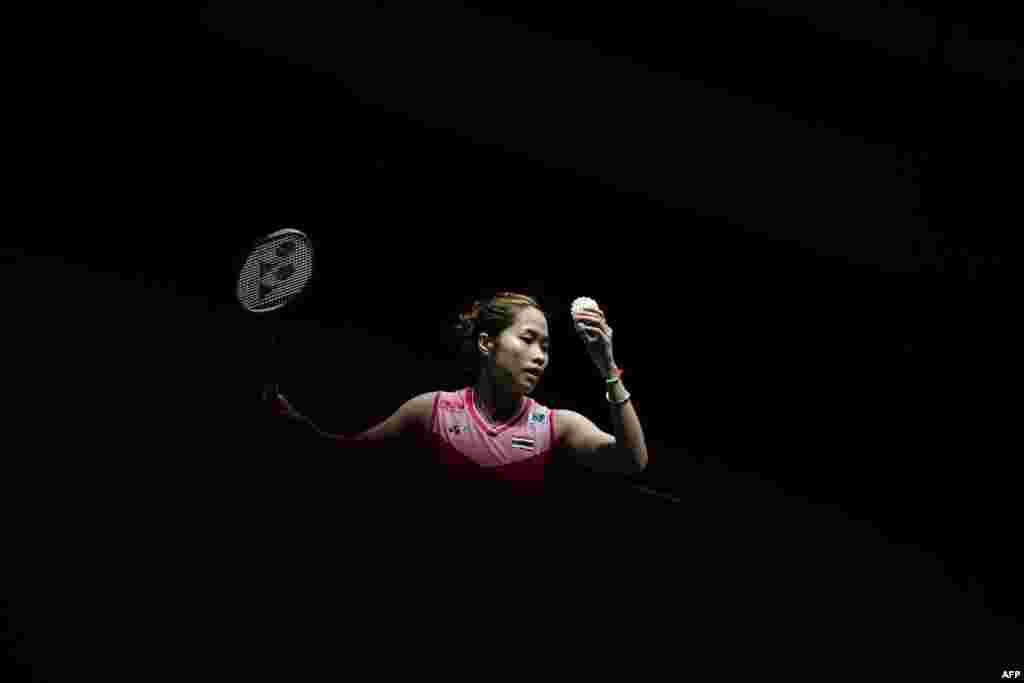 Thailand's Ratchanok Intanon prepares to serve against Zhang Beiwen of the U.S. during a women's singles match at the Malaysia Open badminton tournament in Kuala Lumpur, Malaysia.