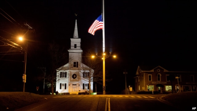 A U.S. flag flies at half-staff on Main Street in honor of the people killed when a gunman opened fire inside a Connecticut elementary school, Saturday, Dec. 15, 2012, in Newtown, Connecticut.
