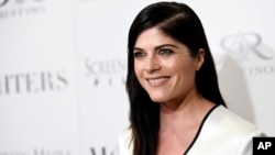 "FILE - Selma Blair, a cast member in ""Mothers and Daughters,"" poses at the premiere of the film at the London West Hollywood Hotel Screening Room."