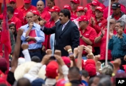 Venezuela's President Nicolas Maduro speaks to oil workers during a demonstration outside Miraflores Presidential Palace after he met with U.S. diplomat Thomas Shannon in Caracas, Venezuela, June 22, 2016.
