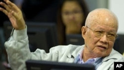 In this photo released by the Extraordinary Chambers in the Courts of Cambodia, Khieu Samphan, former Khmer Rouge head of state, gestures as he sits in the court room U.N.-backed war crimes tribunal in Phnom Penh, Cambodia, Thursday, Aug. 7, 2014.