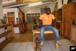 Donkor's been making furniture since he was 14 years of age, but all his attention is now on Ghana's attempt to reach the World Cup semifinals