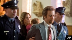 "Hilary Swank starring as Betty Anne Waters and Sam Rockwell as Kenny Waters in ""Conviction"""