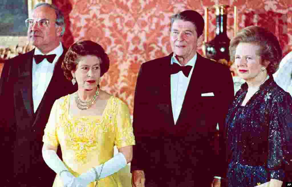 10 июня 1984, Коль на приеме у королевы Великобритании Елизаветы вместе с президентом США Рональдом Рейганом и его супругой Нэнси