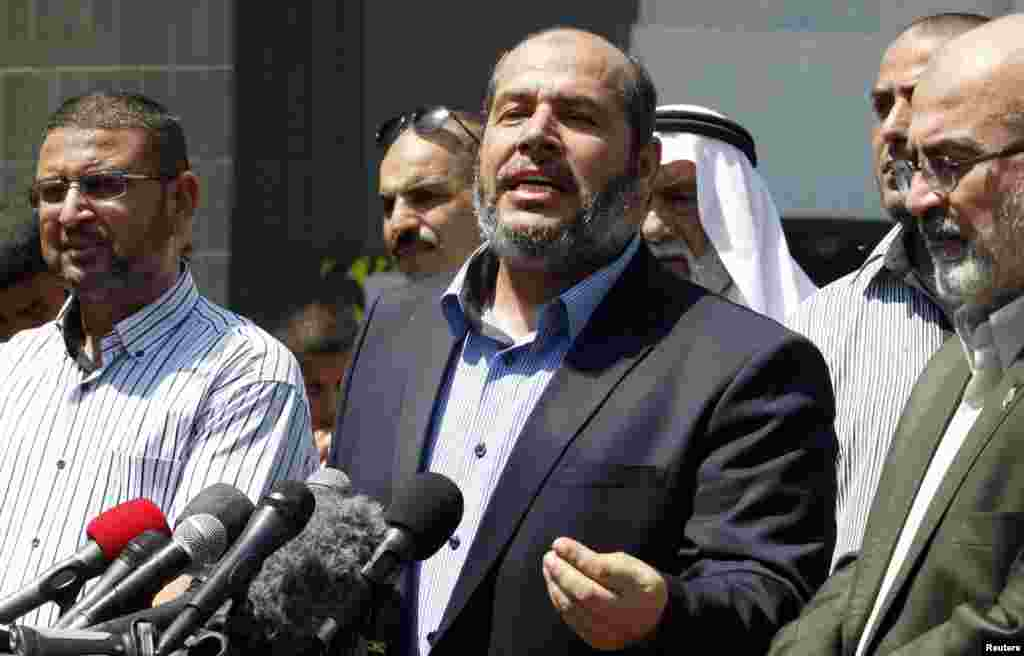 Senior Hamas leader Khalil al-Hayya speaks to the media upon his return to Gaza City from truce talks in Cairo, Aug. 14, 2014