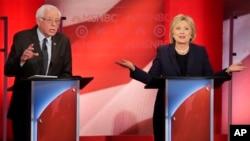 星期四晚上,美国民主党总统参选人希拉里·克林顿和桑德斯在新罕布什尔州城市达勒姆举行辩论会。