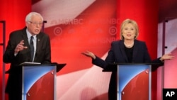 Democratic presidential candidate Senator Bernie Sanders listens to a point made by rival candidate Hillary Clinton during a presidential primary debate hosted by MSNBC in Durham, N.H., Feb. 4, 2016.