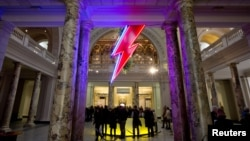 "A neon flash representing David Bowie's ""Aladdin Sane"" stage character is seen at the entrance to the Victoria and Albert Museum to mark the ""David Bowie is"" exhibition in London, March 20, 2013."