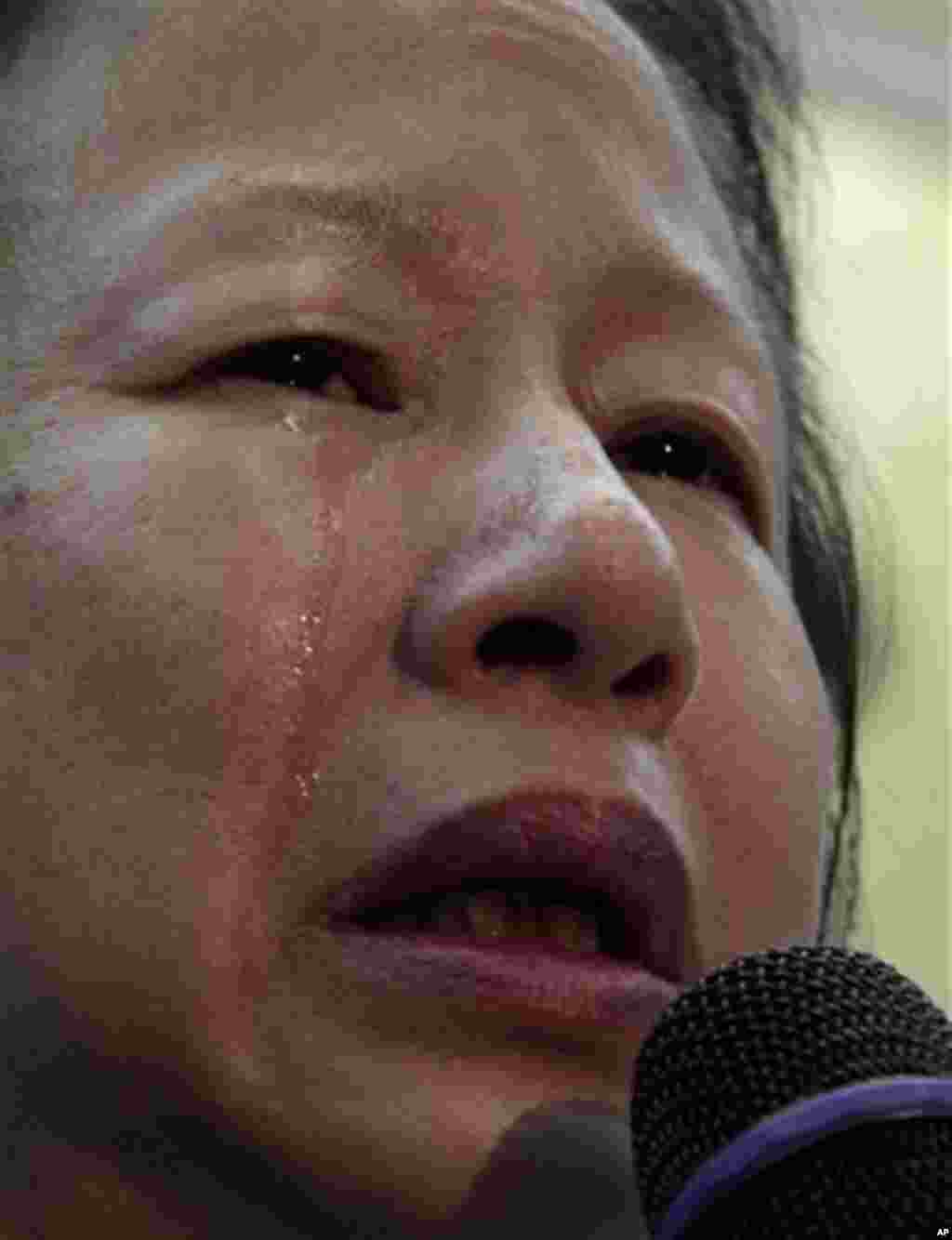 Elizabeth OuYang, president of the New York chapter of the Organization of Chinese Americans, weeps as she speaks about the death of Pvt. Danny Chen during a news conference on Thursday, Jan. 5, 2012 in New York. An update was provided on a Pentagon inve