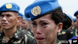 FILE - Philippine Navy Petty Officer 2 Ellen Paculba, one of 157 Philippine troops who were deployed in Haiti as U.N. Peacekeepers, cries during sendoff ceremony, Sept. 22, 2014.