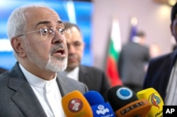FILE - Iranian Foreign Minister Javad Zarif speaks with the media at the Europa building in Brussels, May 15, 2018.