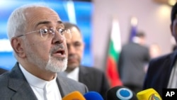 FILE - Iran's foreign minister Mohammad Javad Zarif speaks with the media after a meeting with European Union foreign policy chief Federica Mogherini at the Europa building in Brussels, May 15, 2018.