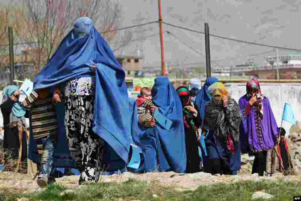 Supporters of Afghan presidential candidate Abdullah Abdullah arrive for an election gathering in Charikar. Afghanistan's April 5 election is the third presidential poll since the fall of the Taliban with 11 candidates contesting the polls.