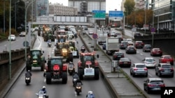 Farmer drive their tractors on the Paris ring road in Paris, France, Nov. 27, 2019.
