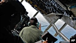 Brazilian Air Force officers look for signs of Air France flight 447 as they patrol the crash area in the open Atlantic Ocean some 745 miles (1,200 km) northeast of Recife (file photo)