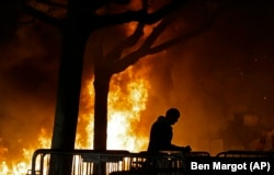 A fire set by demonstrators protesting a scheduled speaking appearance by Breitbart News editor Milo Yiannopoulos, burns on the University of California at Berkeley campus in February 2017.