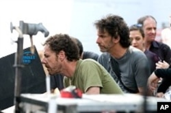 Left to right: Directors/Co-Writers Ethan and Joel Coen on the set of their film, TRUE GRIT.