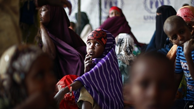 Somali refugees wait outside the UNHCR registration center in the Eastern Kenyan village of Hagadera near Dadaab, 100 kms (60 miles) from the Somali border, August 12, 2011