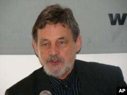 約翰莫蘭可夫, 紐約市立大學城市發展研究所教授