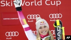Lindsey Vonn celebrates on the podium after winning the women's World Cup super-G in Cortina d'Ampezzo, Italy, Jan. 19, 2015.