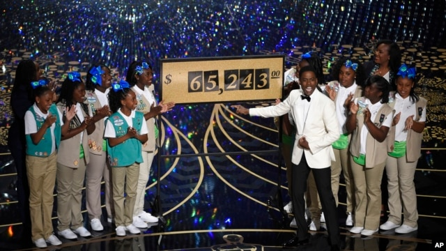 Host Chris Rock and Girl Scouts participate in a skit at the Oscars on Feb. 28, 2016, at the Dolby Theatre in Los Angeles.